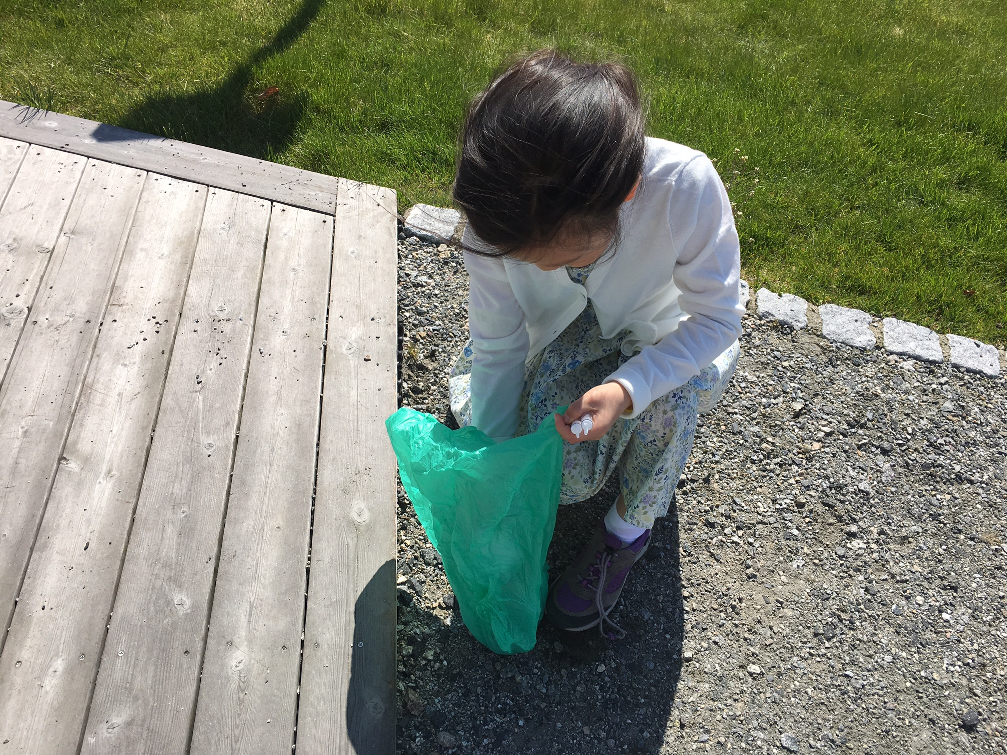 Keira picking rocks