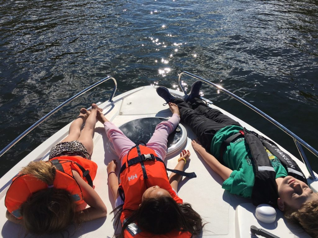 3 kids on boat